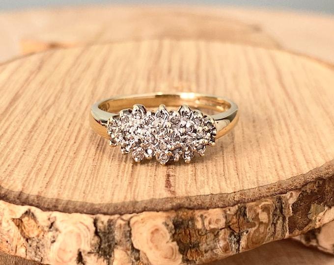 Gold diamond ring. A 9k yellow gold diamond cluster ring.