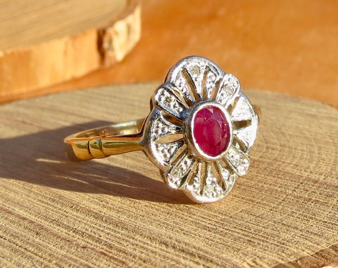 Gold ruby ring. A 9K yellow and white gold 1/3 carat ruby and diamond ring.