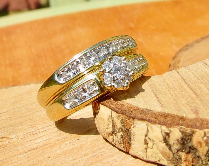 A set of 9k yellow gold diamond rings.