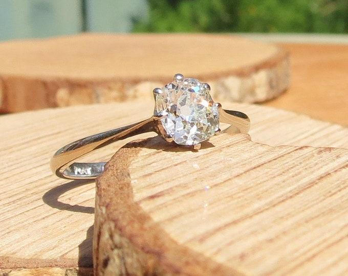 Platinum diamond ring. A platinum 0.9 carat solitaire 'cushion cut' diamond ring.
