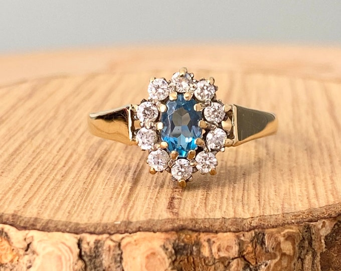 Gold CZ ring. 1960s vintage 9K yellow gold blue stone with white stone halo.