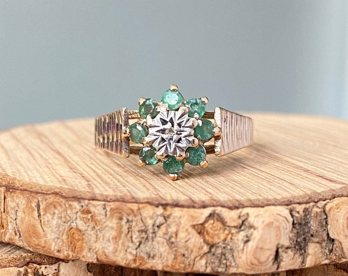 Gold emerald ring. Vintage 1970s 9K yellow gold green emerald daisy ring with an illusion set diamond.