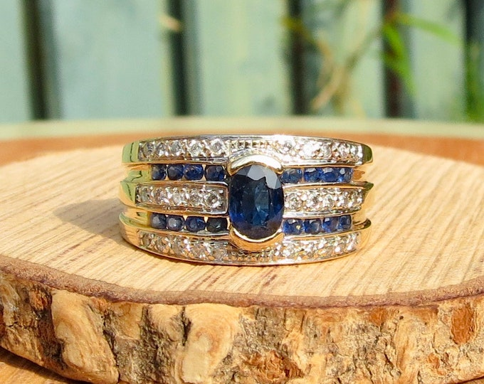 Gold sapphire ring. Wide band 9k yellow gold diamond and sapphire ring