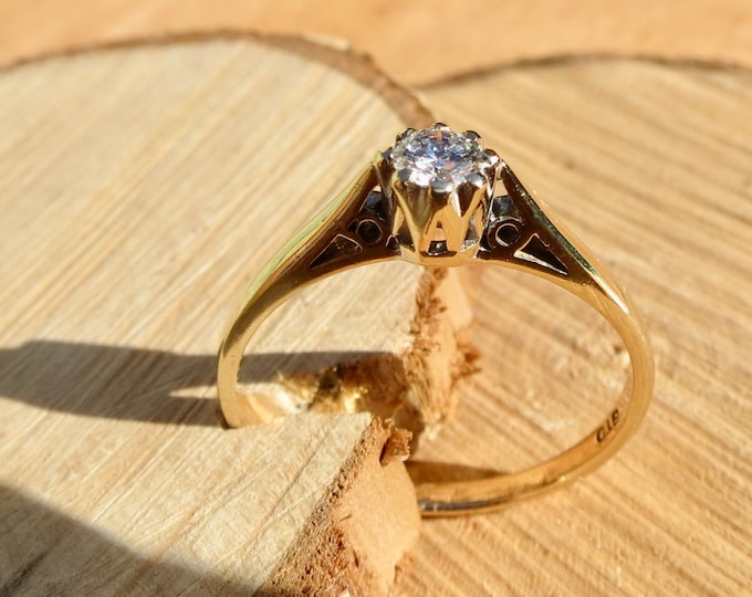 A 1/5 carat Diamond solitaire 9k yellow gold ring.
