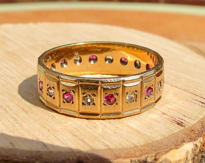 A little 9K yellow gold ruby and white topaz full eternity ring