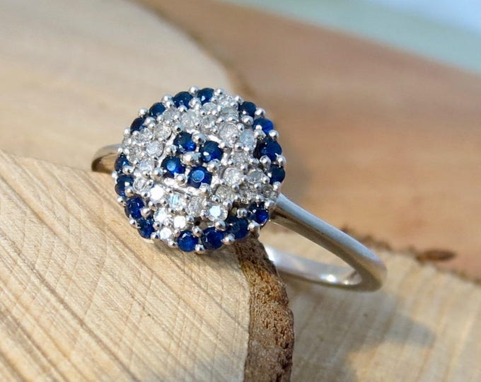 9K white gold sapphire and diamond cluster ring.