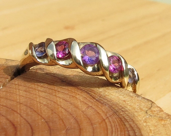 A fine vintage 9k yellow gold, amethyst and tourmaline ring