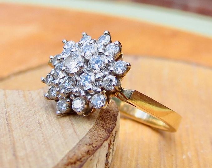 Gold diamond ring. A 14k yellow gold 1.35 ct diamond star cluster ring.