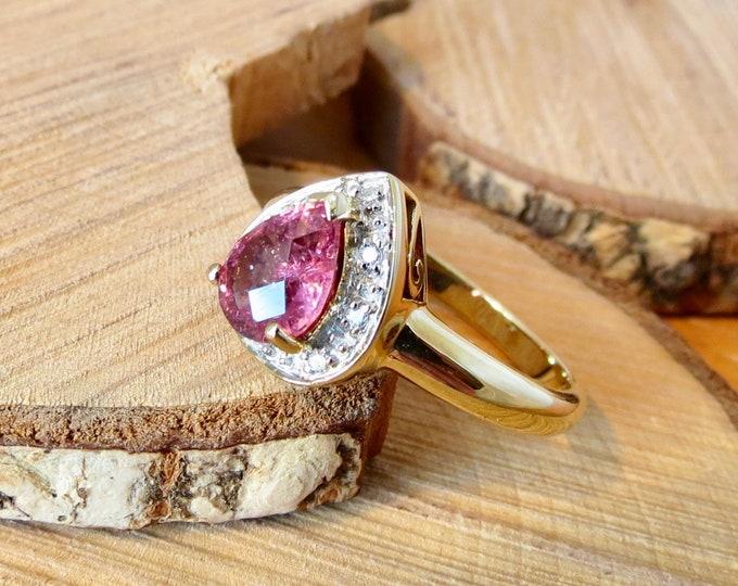 A 9k yellow gold, pink tourmaline and diamond ring