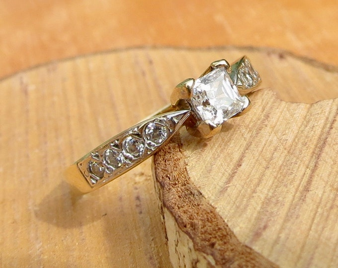 A 9K yellow gold princess cut cubic zirconia solitaire ring.