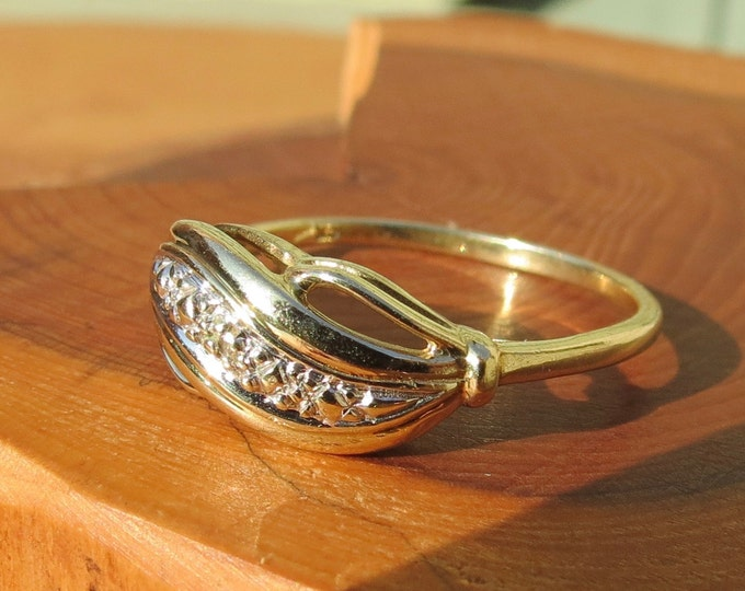 A vintage 9k yellow gold diamond ring