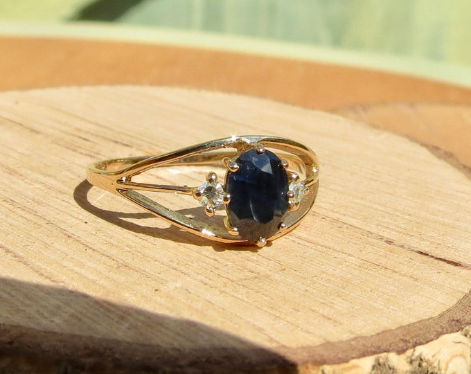 A vintage 9k yellow gold 1 carat blue sapphire and diamond ring.