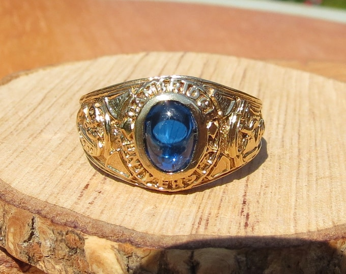 Gold fraternity ring, Cambridge University, Blue sapphire cabochon.