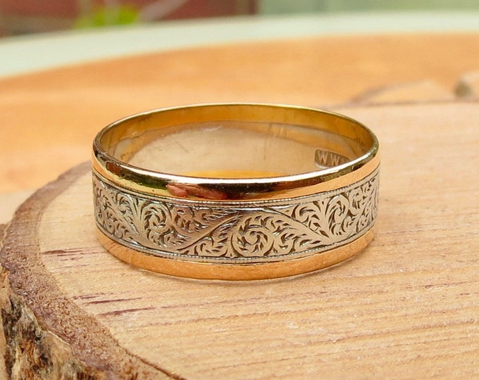 Antique platinum and 22K yellow gold hand engraved band.