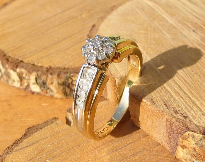 Gold diamond ring. A vintage 10k yellow gold 1/3 Carat diamond cluster ring.