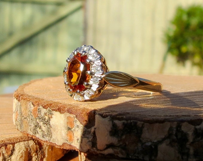 A 18K yellow gold, cinnamon tourmaline (dravite) and diamond ring