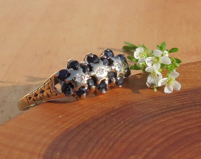 Gold sapphire ring. A large sized vintage 9k yellow gold diamond and sapphire ring
