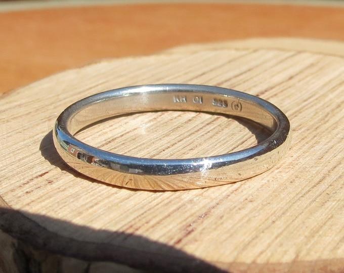 Large silver ring, narrow band.