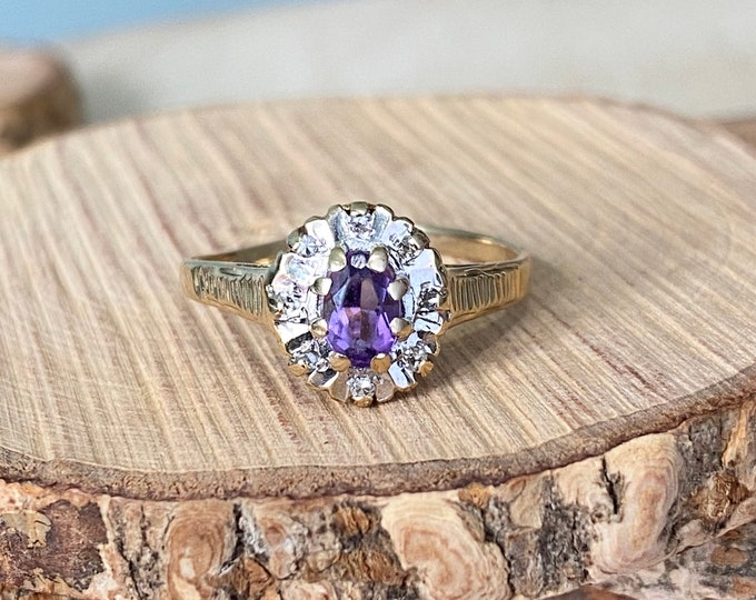 Gold amethyst ring. 9K yellow gold purple amethyst with a diamond halo.