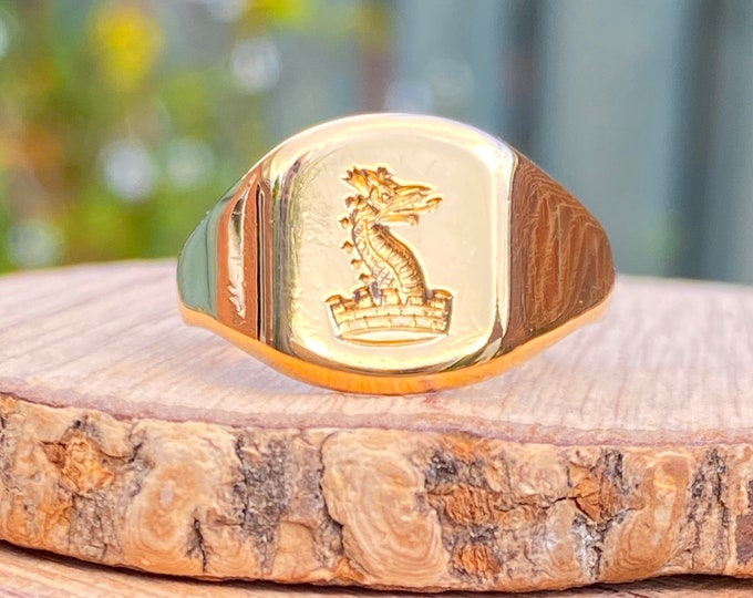 Gold signet ring. Vintage 1950's, 18K yellow gold, dragons head and Mural Crown signet ring. From the Archer family, Baron of Umberslade.