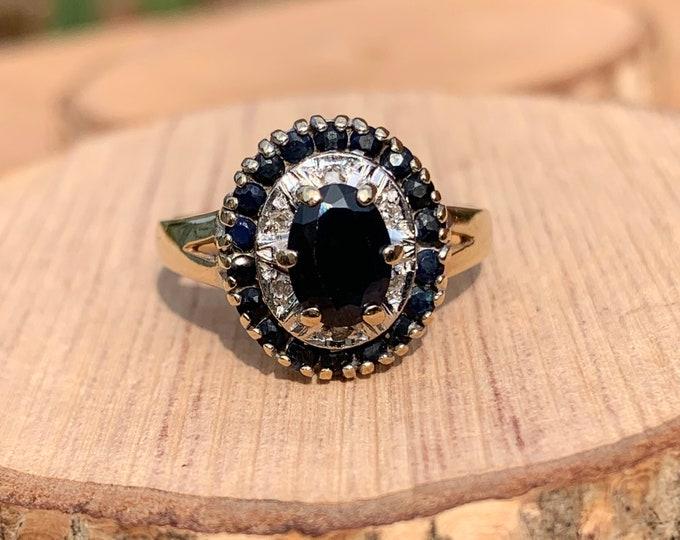 Gold sapphire ring. 9K yellow gold 3/4 carat sapphire and diamond ring.