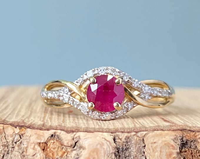 Gold ruby ring. A 9K yellow gold 1/3 carat ruby and diamond ring.
