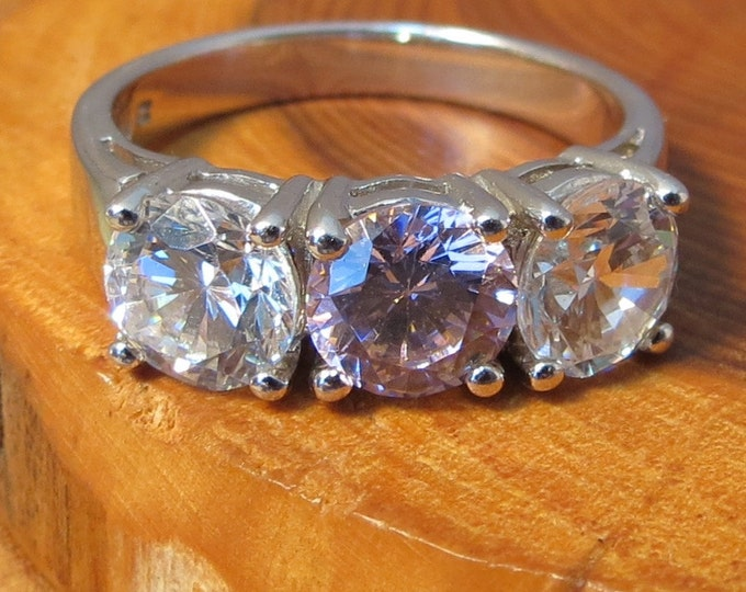 A vintage silver, pink and white cubic zirconia trilogy ring