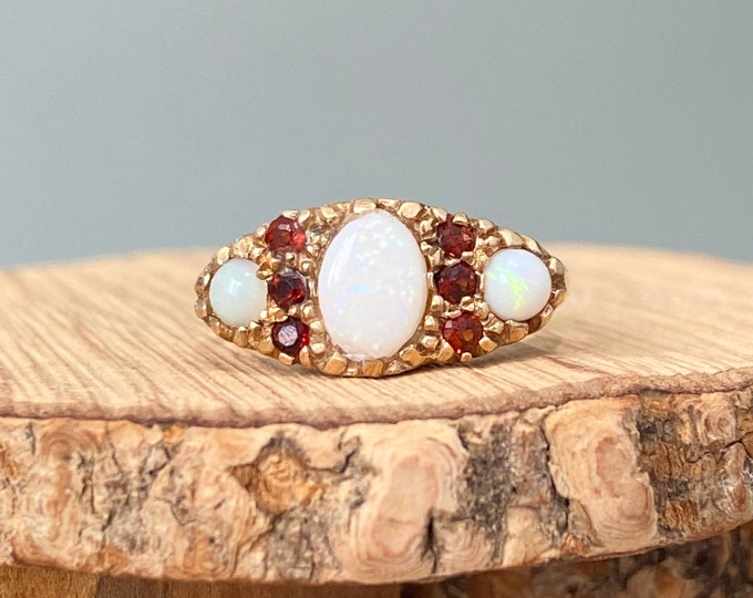 Gold opal ring. A petite size vintage 9K yellow gold opal and red garnet trilogy ring