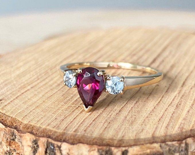 Gold red ring. 9K yellow gold ring with red lab created rubellite and white topaz accents.