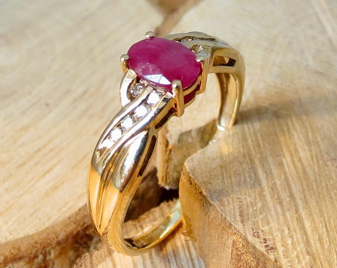 Gold ruby ring. A 9K yellow gold ruby and diamond ring.
