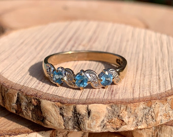 Gold topaz ring. A 9k yellow gold sky blue topaz ring with diamond accents.