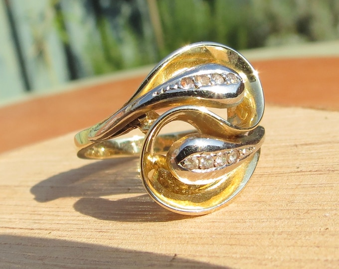 Gold floral ring. A vintage 14k yellow gold and white stone ring