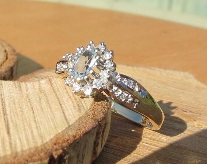 Gold aquamarine ring. Petite 9k yellow gold 1/5 carat aquamarine and diamond ring