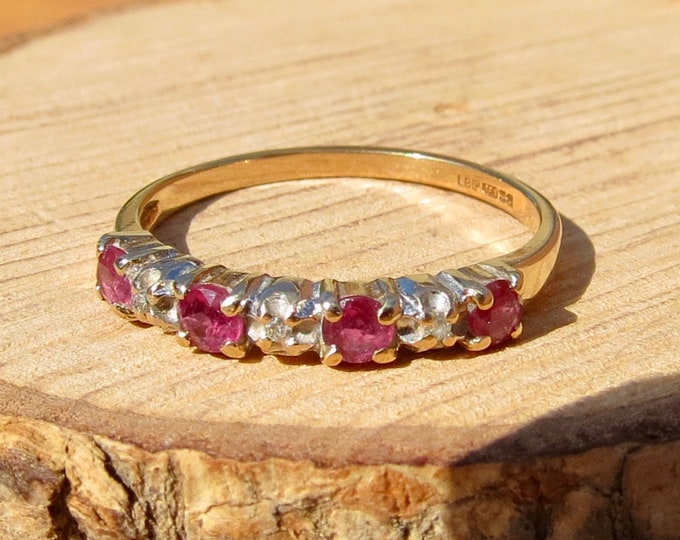 Narrow band 9K yellow gold ring, with round rubies and diamond accents