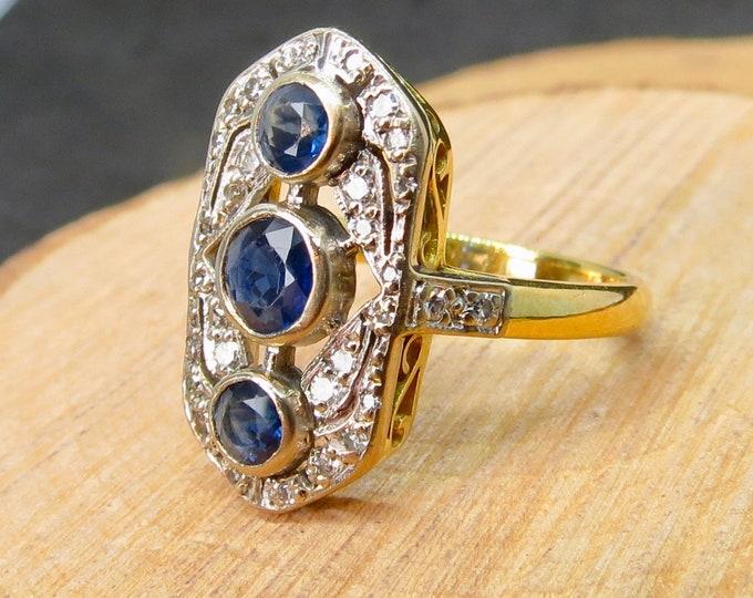 18K  yellow gold sapphire and diamond ring.
