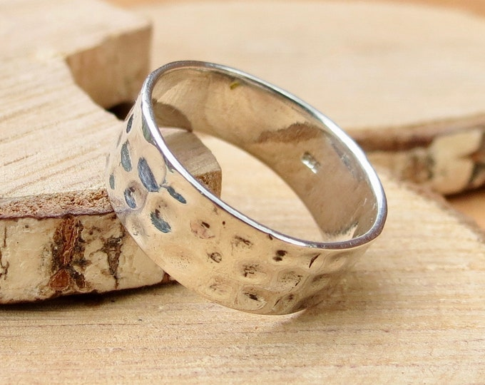 Silver ring, decorated wide band.