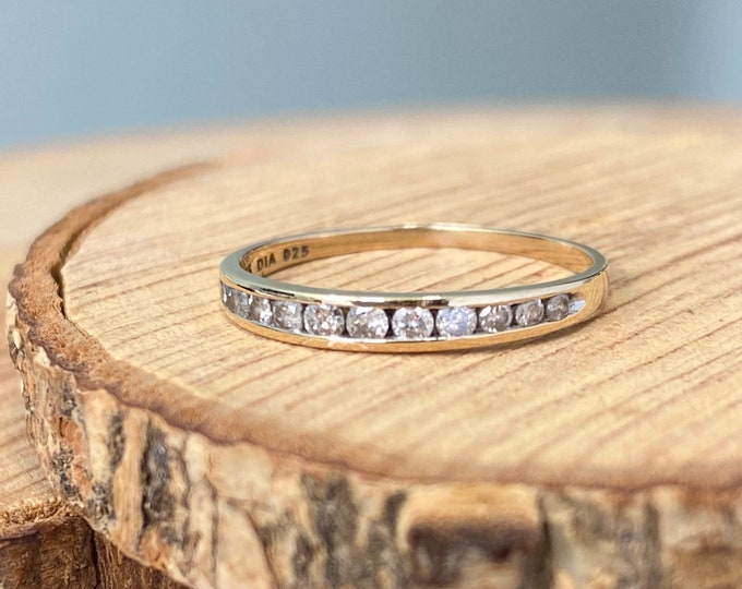 Gold diamond ring. A 9k yellow gold 1/4 carat 12 diamond ring.