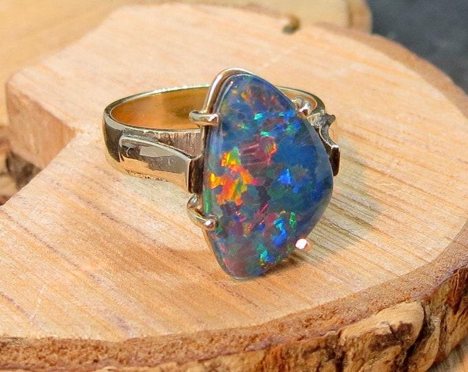 A vintage 9k gold black opal ring
