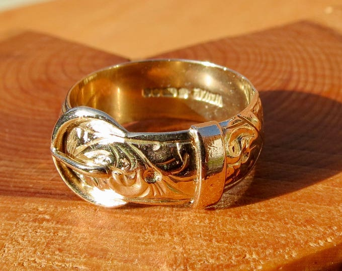 A 9K yellow gold decorated Buckle ring, made in 1977