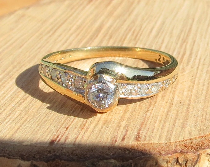 Gold diamond ring. A vintage 18k yellow gold 1/4 Carat diamond solitaire ring.