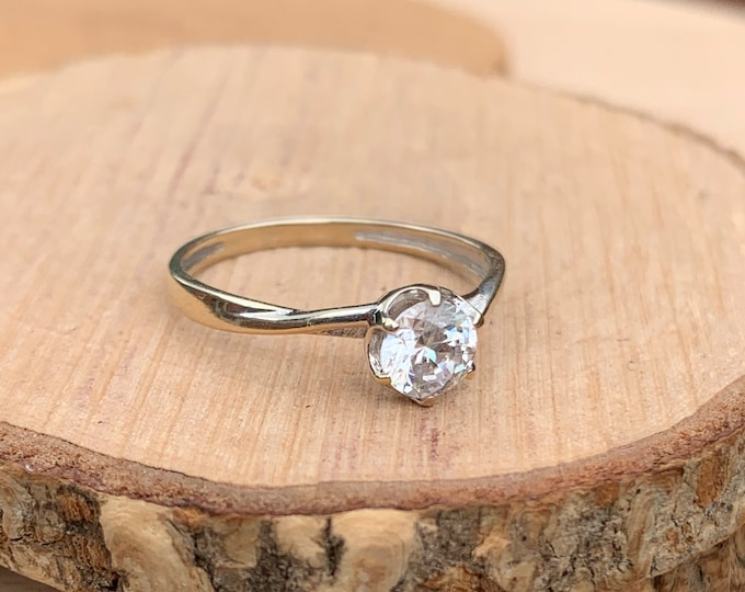 Gold CZ ring. A 9K white gold round cut cubic zirconia solitaire ring, with a heart and crown setting.