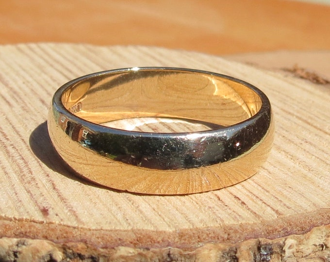 Gold wedding ring. Wide 9K yellow gold court profile band.