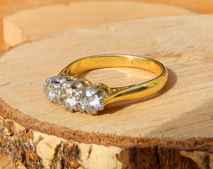 A small sized 18k yellow gold 1/3 carat diamond trilogy ring