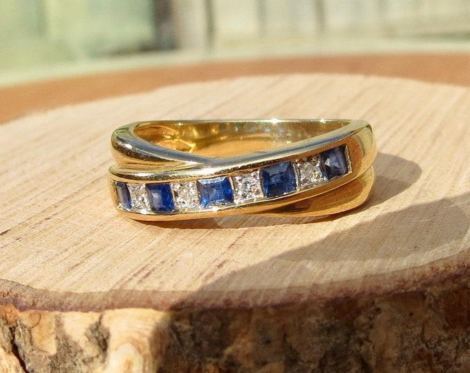 9K yellow gold sapphire and diamond crossover ring.