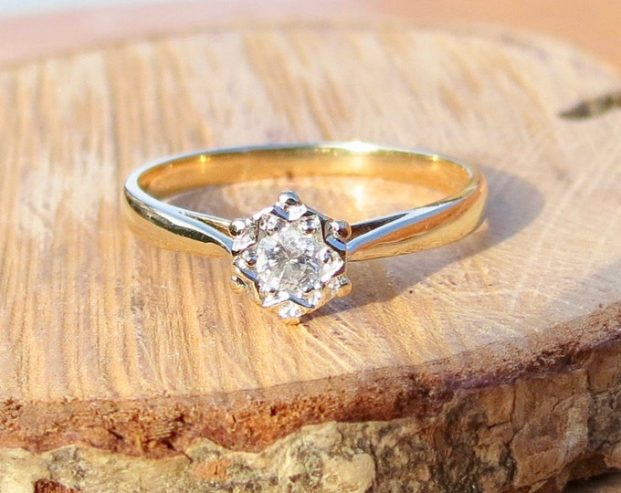 9K Yellow gold diamond solitaire ring.