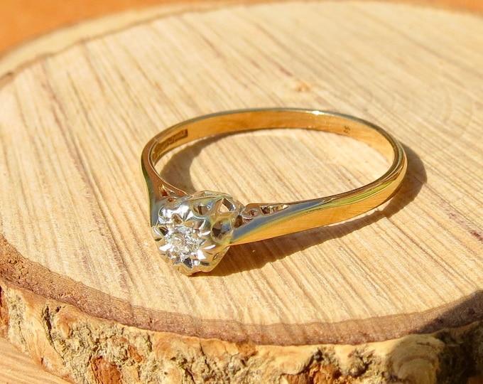 Gold diamond ring. A 1/10 Carat diamond solitaire 9k yellow gold ring.