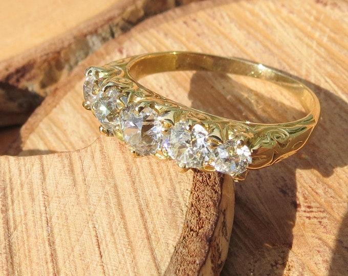 Gold diamond ring. Antique 18k yellow gold 1.2 carat diamond graduated 'old mine cut' five stone ring.