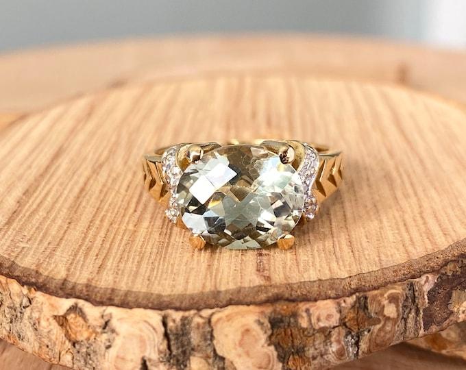 Gold amethyst ring. 18K yellow gold 2 1/2 carat green amethyst and diamond ring.