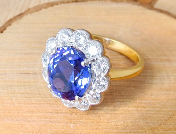 18K yellow gold 6 carat tanzanite and 1 1/2 carat diamond ring.