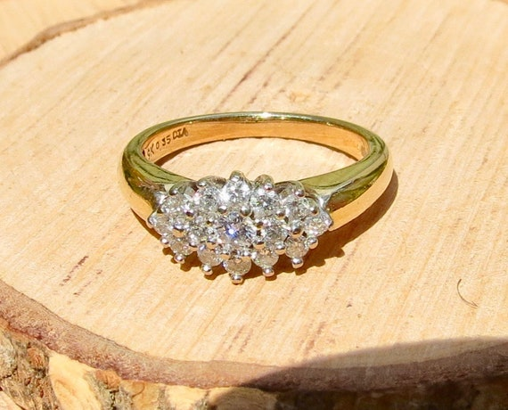 A vintage 9k yellow gold 0.35 Carat diamond cluster ring.